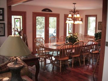 Hardwood floors thoughout main level. Dining room seats 12