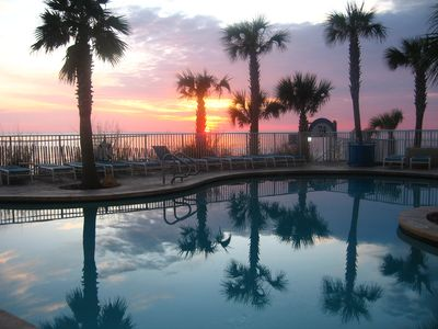 Splash Resort condo rental - Sunset over the East Tower pool - adjacent to the RipTide Grill