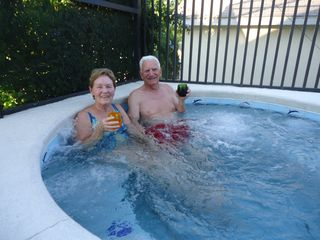 Indian Creek house photo - Your hosts enjoying the spa. We're here a week or two in spring & fall. Enjoy