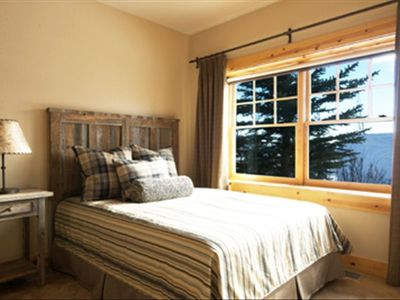 Sunny guest bedroom suite with reclaimed snowfence wood queen bed & furniture