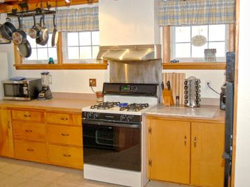 Big, bright kichen with two ovens and dishwasher
