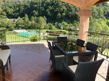 Upper Level Patio - With gorgeous views, BBQ, Seating Area and Dining Table.