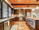 Kitchen - A kitchen island offers ample space to prep meals.