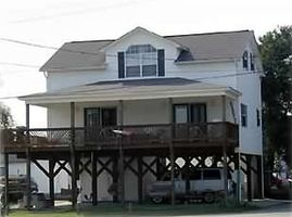 Front Of House ,  covered porch  and parking area ,  4 swings, picnic tables