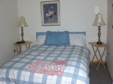 upstairs sleeping area - queen bed with last year's comforter