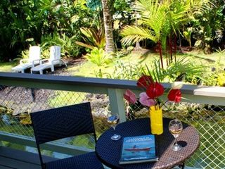Pahoa cottage photo - Great place to sip a glass of wine and watch the fish in the pond