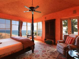 Malibu house photo - South facing master with stunning ocean views, fireplace, library, sitting room.