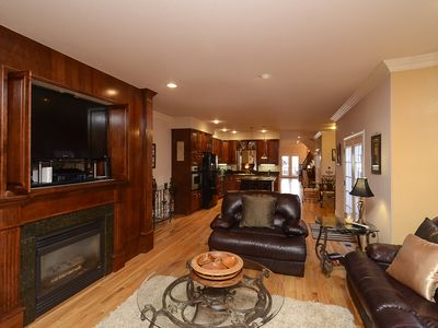 Family room with 3D flat screen and satellite TV and DVR.