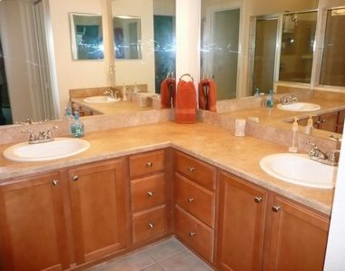 Master Bath with large walk-in tile shower and His & Hers Vanity....