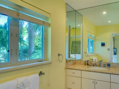 The third en-suite bathroom has granite counter top and shower.