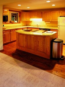Fully applianced and equipped granite kitchen, hardwood floor