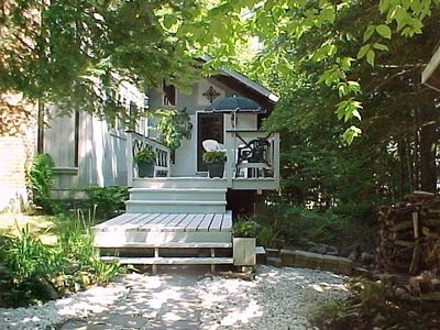 Great summer deck to a fun vacation home 100 yards from mountain swim pond