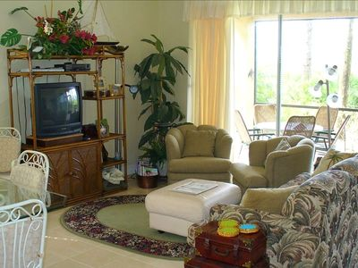 Living Room and 14 foot Lanai with Golf Course View.