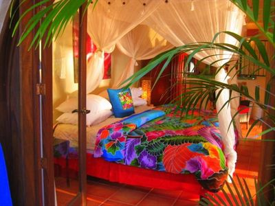 bungalow' suite's king bed - water view and fully enclosed
