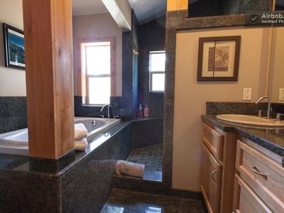 Upstairs bath with double vanity, granite shower and soaking tub