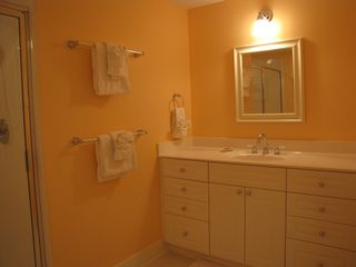 Fort Walton Beach condo photo - Guest bath vanity and walk-in-shower with 6-way shower/massage head.