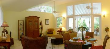Spacious Great Room, Vaulted Ceilings, French Doors Lead to Veranda and Pool