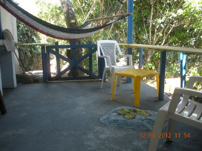 patio: hammock, chairs, table