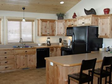 Large Country Kitchen with Cozy Breakfast Bar; Fully Equipped for your Needs.