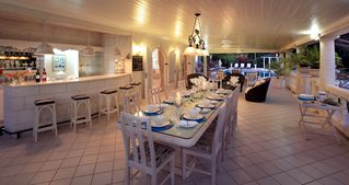 Sandy Lane villa photo - Dining with seating for 12 on the covered terrace at Vistamar villa in Barbados