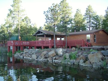 Pinetop cabin rental - 800 square foot deck hangs over Rainbow Lake