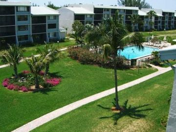Stroll through the beautifully landscaped courtyard for a dip in the pool.