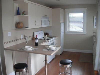 Kitchen: bright & spacious; range, MW, FR/FR, DW; private balcony to right