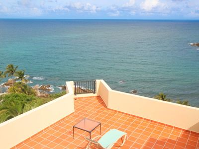 Incredible oceanfront location with the beach below! Fabulous rooftop lanai!
