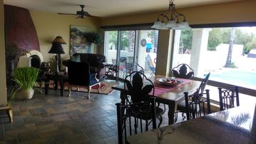 Phoenix house rental - Family room with a pool view.