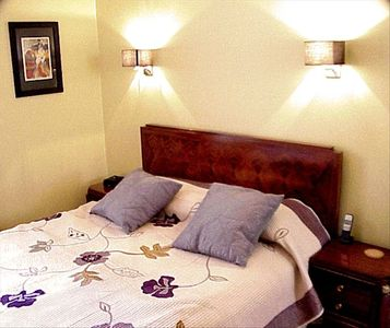 The bedroom features quality linens and abundant storage.