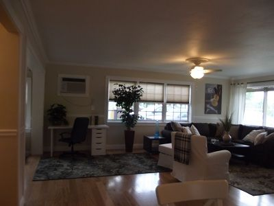 The living room/office area is spacious and airy.