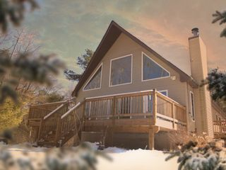 Yulan chalet photo - Lighthouse in winter. Cathedral windows let in tons of light.