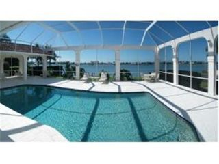 Vacation Homes in Marco Island house photo - Large Pool and Lanai. Great for entertaining!