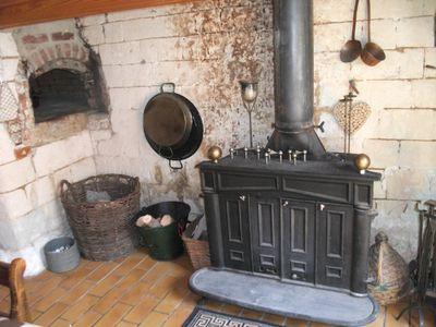 The log fire and bread oven (not in use)