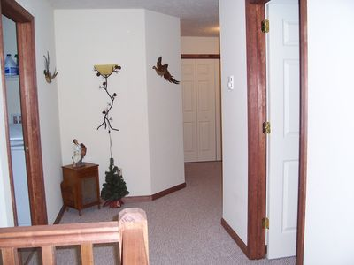 Upstairs hallway showing laundry room on left