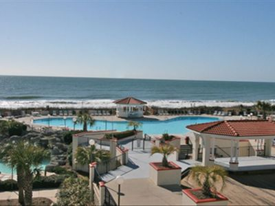 View of ocean, courtyard and multiple pools from private 3rd floor balcony