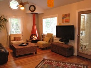 Lakeway cottage photo - Living room has a wood burning fireplace, flat screen TV and DVD player.