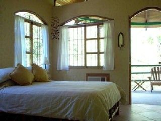 Manuel Antonio house photo - Bedroom two opens to balcony: King bed