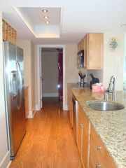 Wrightsville Beach condo photo - Modern kitchen with granite countertops and stainless steel appliances