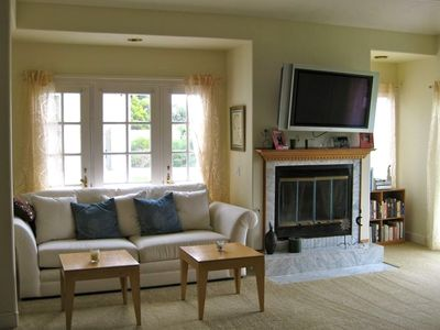 Master BR sitting area, fireplace, Large Flat tv over fireplace!  View of Ocean