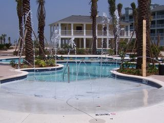 Galveston condo photo - Enjoy the lazy river pool and beautiful sunsets in the hot tub.