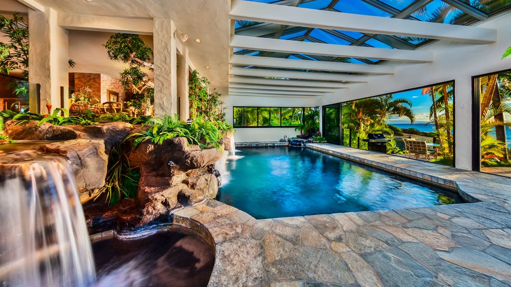 Waterfalls over lava rock and with pool vrbo for Hawaii package homes