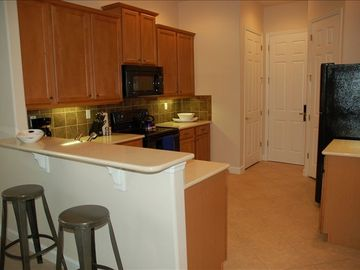 Spacious kitchen, granite counters, breakfast bar, fully equipped for any meal!