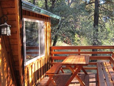 Eat out on the deck with views of the slopes surrounded by trees