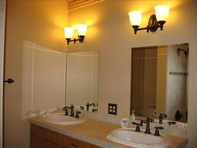 Spacious Main Floor Bath with Double Sinks, Tub, & Shower. Clean and roomy