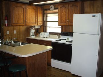 Fully equipped kitchen area with ample cabinet space.
