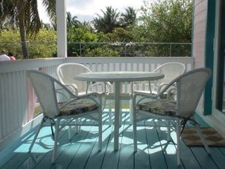 Outside porch with sea view - Spanish Wells cottage vacation rental photo
