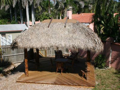Lounge or dine in our tiki hut, built by the Florida Seminole Indian tribe