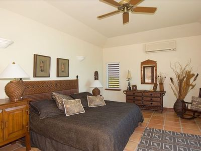Master  bed in main house  - walk in wardrobe, spacious rain head shower and tub