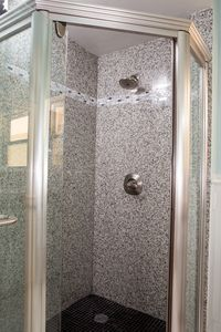 Paso Robles house rental - Large granite walk-in shower in the hallway bathroom.